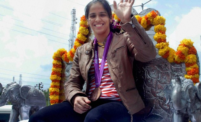 Olympic bronze medallist shuttler Saina Nehwal responds to the fans at a welcome ceremony...