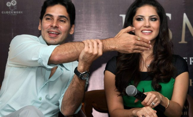 Sunny Leone and producer Dino Morea during a promotional campaign