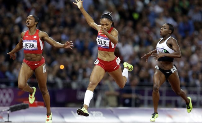 United States\' Allyson Felix crosses the finish line to win the women\'s 200-meters final ahead of...