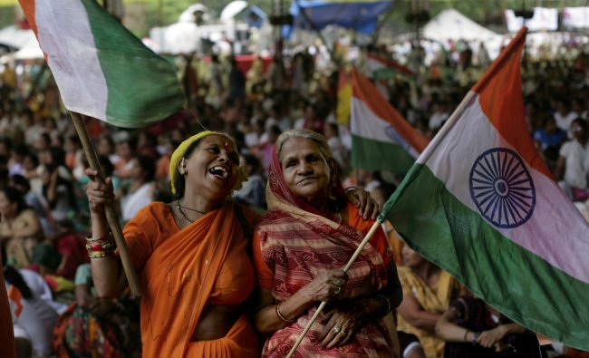 Supporters of Baba Ramdev wave Indian flags during a mass anti-corruption protest