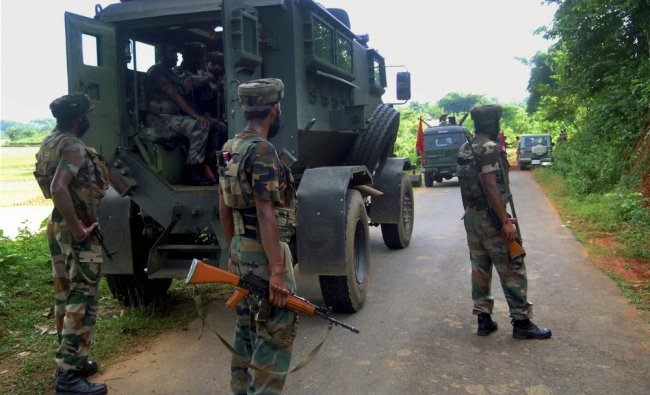 Security jawans at the site of an IED blast at Kishnoi...