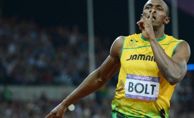 Jamaica\'s Usain Bolt celebrates after winning the men\'s 200m final next at the athletics event...
