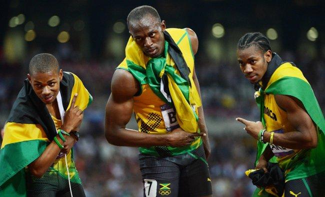 Jamaica\'s Usain Bolt (C) celebrates with Jamaica\'s Yohan Blake (R) and Jamaica\'s Warren Weir (L)...