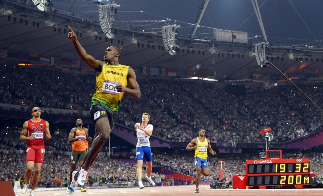 Jamaica\'s Usain Bolt celebrates after winning the men\'s 200m final at the athletics event during...