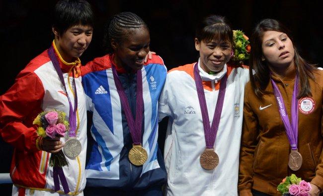 Gold medalist Britain\'s Nicola Adams (2ND-L), Silver medalist China\'s Cancan Ren (L), Bronze...