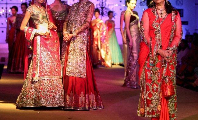 Bollywood icon Sharmila Tagore (R) displays creation of designer Ashima Leena during the fashion...
