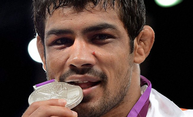 India\'s Sushil Kumar with Silver medal after Men\'s 66kg Freestyle Semifinal match ....