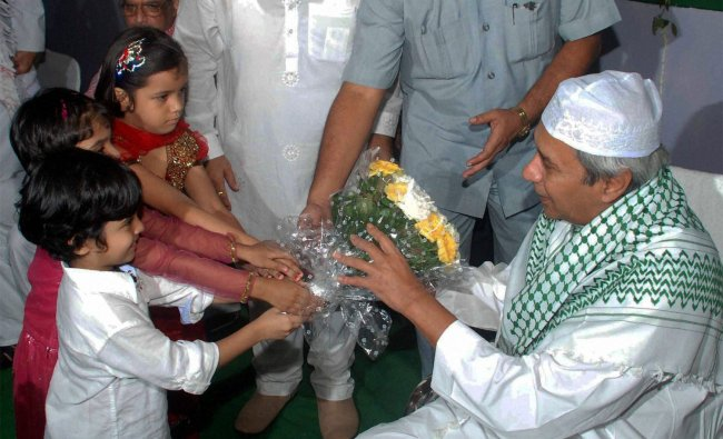 Odisha Chief Minister Naveen Pattnaik being greeted by children during an Iftar party...