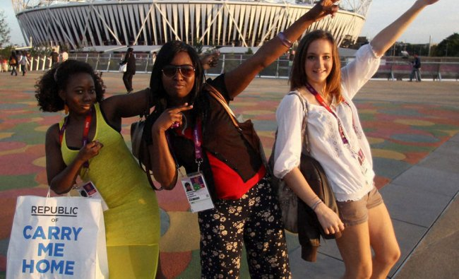 Fans of Jamaica\'s Usain Bolt pose in front of Olympic Stadium