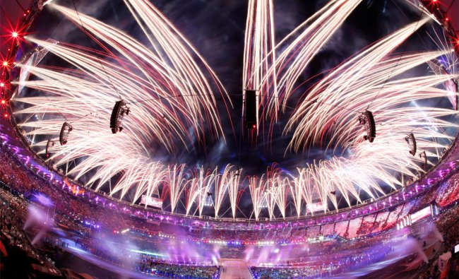 Pyrotechnics illuminate the sky above the Olympic Stadium during the Closing Ceremony