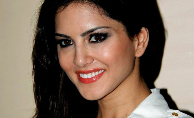 Sunny Leone poses during a promotional event for a music company