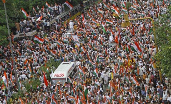 Supporters of Indian yoga guru Baba Ramdev hold Indian national flags