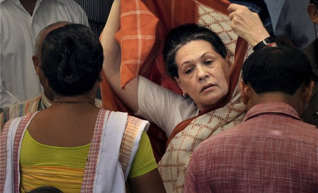 Sonia Gandhi while meeting riot-hit people at a relief camp at Denborgaon in Kokrajhar district
