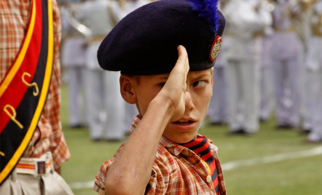 A Kashmiri student salutes during a rehearsal for the Indian Independence Day celebrations, Srinagar