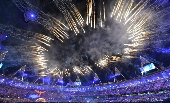 Firewords explode over the Olympics Stadium during the closing ceremony of the 2012 London...