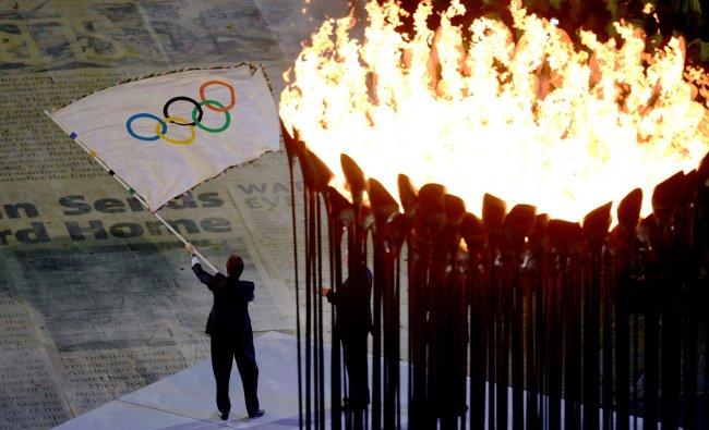 The Mayor of Rio de Janeiro, Eduardo Paes, waves the Olympic flag during the Closing Ceremony of...