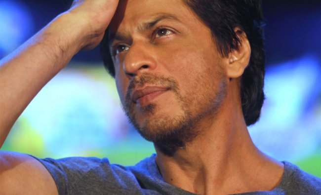 Shahrukh Khan gestures as he speaks to media during an event in Mumbai
