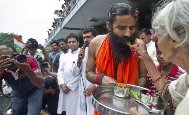 Indian yoga guru Baba Ramdev breaks his fast at Ambedkar stadium in New Delhi