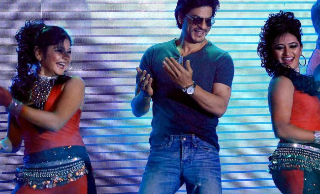 SRK performs during the announcement of a partnership between Videocon and Digital Direct Broadcast