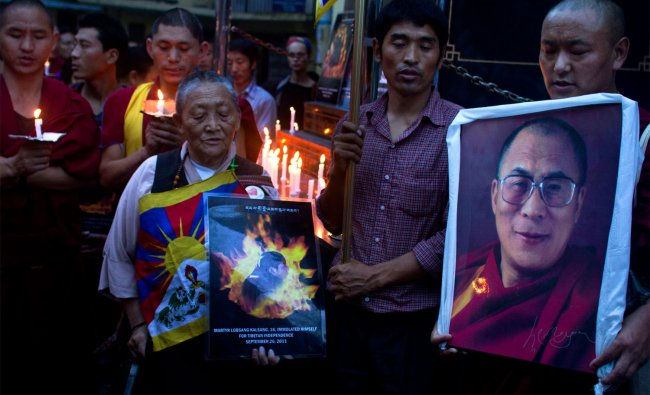 Exile Tibetans during a candlelit vigil in solidarity with Tibetans who self-immolated in Tibet...