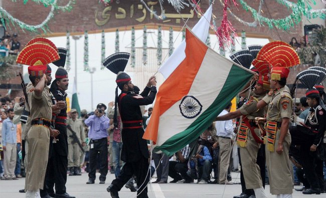 Pakistani Rangers and BSF perform the flag off ceremony at Wagah border...