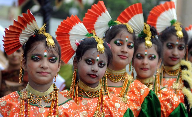 Indian school children wait to perform during Independence day celebrations
