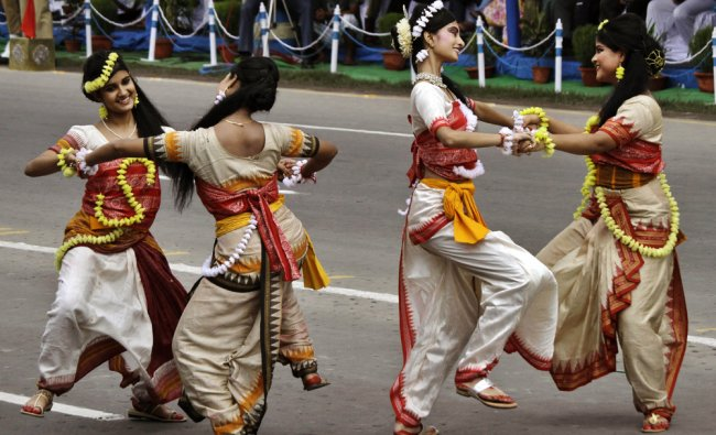 School girls perform on the occasion of 66th anniversary of India\'s independence