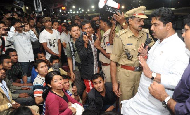 Home Minister R Ashoka adress north-eastern passengers at Bangalore railway station