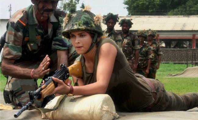 An Army commando instructs bollywood actress Deepika Padukone who tries her hands at a gun ...