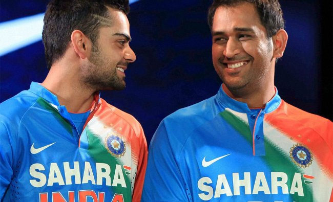 Virat Kohli and Dhoni during the unveiling of new uniform for T20 world cup in Mumbai ...