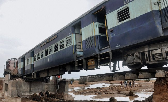 A train on a track washed away in heavy rain at Village Diyatra, in Rajasthan ...