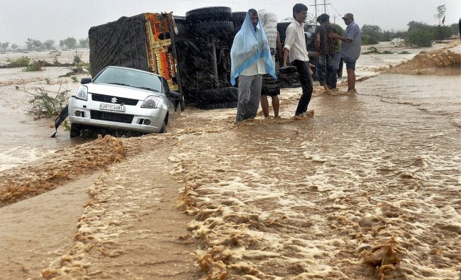 Vehicles struck on a water logged street after heavy rainfall in Bikaner ...