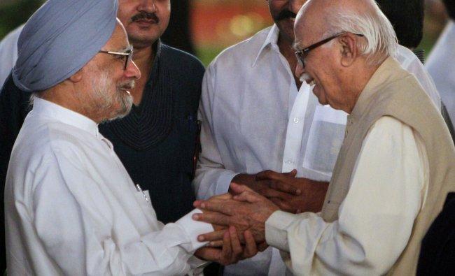 Manmohan Singh shakes hands with Advani at an Iftaar Party at 7RCR in New Delhi...