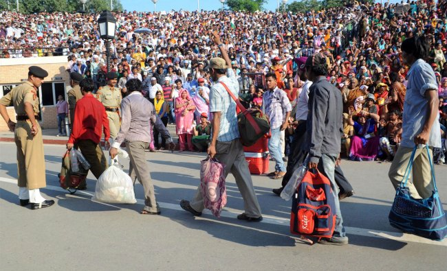 Released Indian fishermen cross over the border at the India-Pakistan Wagah Border Post ...