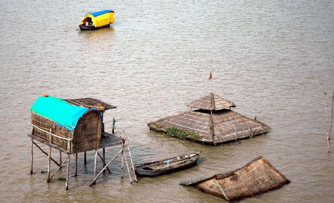 Submerged huts of sadhus at Sangam in Allahabad after rise in the water level of Ganga & Yamuna...