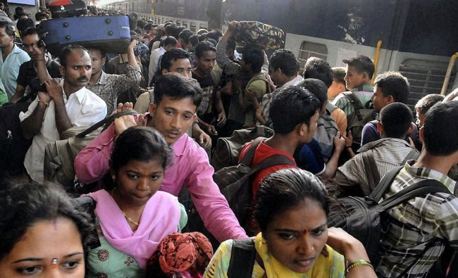 Students of North Eastern states fleeing the city of Pune after rumours of attacks on Thursday...