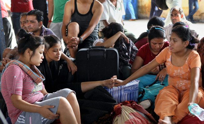 People from North Eastern states wait to board a train at Chennai Central railway station on Friday