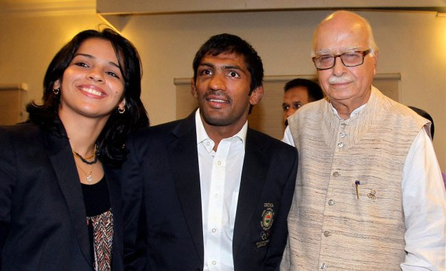 Senior BJP leader LK Advani poses for a photo with medal winners of London Olympics Yogeshwar...