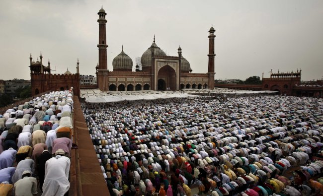 Muslims offer prayer on the last Friday of the holy month of Ramadan at Jama Masjid, in New Delhi.