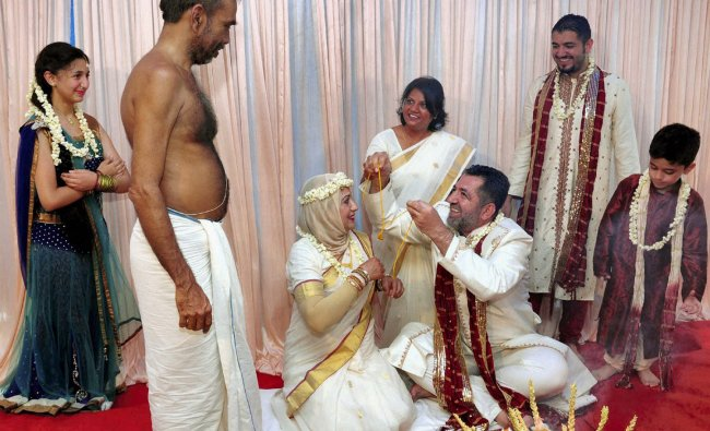 Mufiq and Elena from Syria during their marriage according to Indian customs in Koothattukulam in...