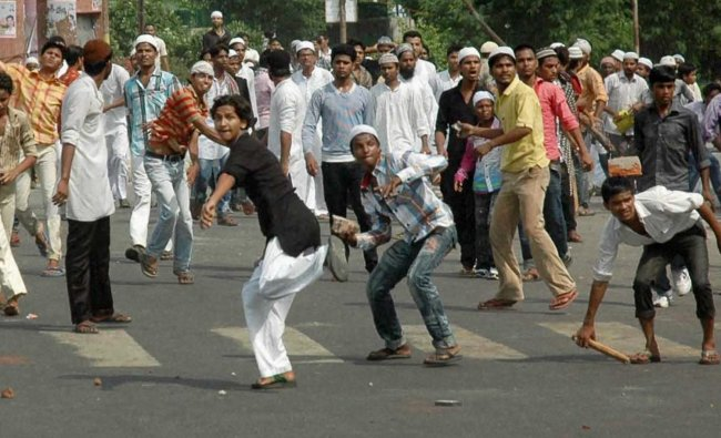 Muslim protesters pelt stones at police in Lucknow on Friday during a demonstration over Assam...
