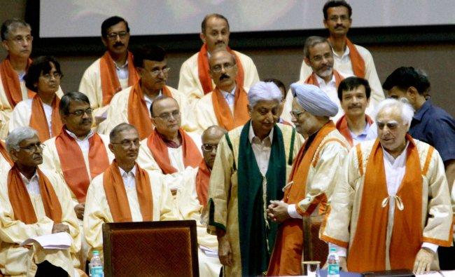 Prime Minister Manmohan Singh, HRD Minister Kapil Sibal and industrialist and philanthropist...