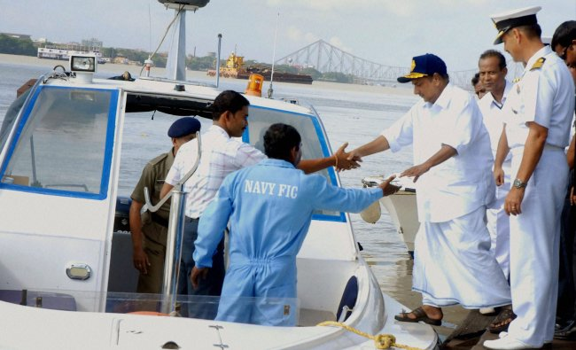 Defence Minister A K Antony takes a ride to visit GRSE (Garden Reach Shipbuilders and Engineers...