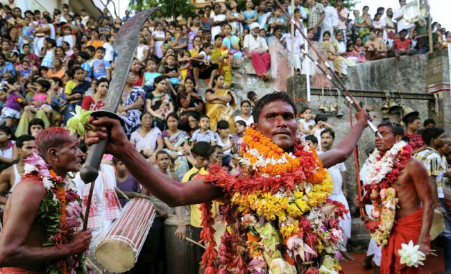 Priests perform Deodhani dance during the Deodhani festival at Kamakhya Temple near Guwahati on...