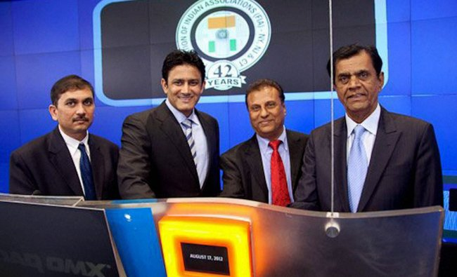Cricketer Anil Kumble with members and officials of the Federation of Indian Associations ringing...