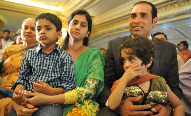 Cricketer Vangipurappu Venkata Sai (VVS) Laxman (R), wife Sailaja amd their children Sarvajith...
