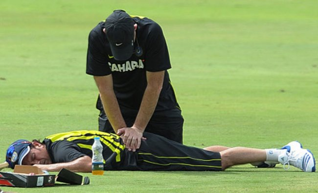 Indian cricketer Sachin Tendulkar gets treatment from a physiotherapist during a training session...