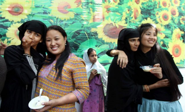 Students from Northeast with Muslim women during Eid celebrations ...