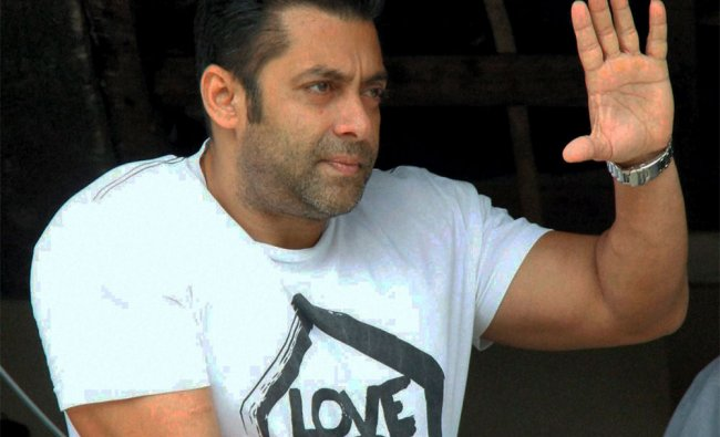 Bollywood actor Salman Khan waves to his fans from his house on Eid festival...