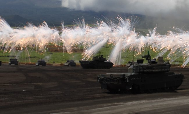Japanese Ground Self-Defense Force armoured tanks fire during an annual training session near Mt...